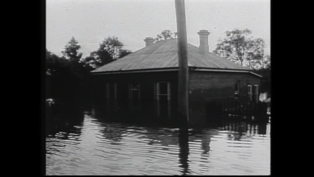 VARIOUS SHOTS OF FLOOD WATERS OUTSKIRTS OF PERTH ALONG BANKS OF SWAN RIVER / VARIOUS SHOTS OF FLOODED HOUSES AT BASSENDEAN / VARIOUS SHOTS OF...