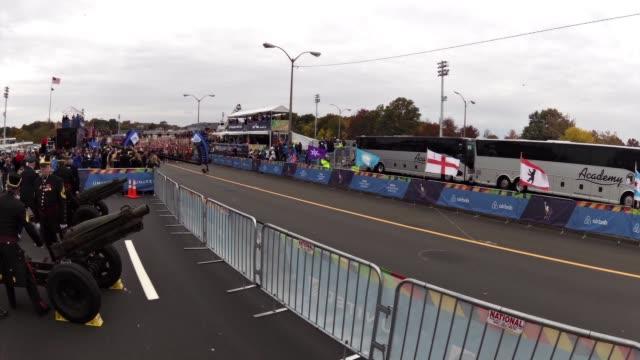 new york city marathon thousands start in staten island and head across verrazano bridge to brooklyn canons fire starting race - salmini stock videos and b-roll footage
