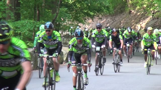 thousands of cyclists ride along the henry hudson drive and up the alpine hill 100 mile race distance - salmini stock videos and b-roll footage