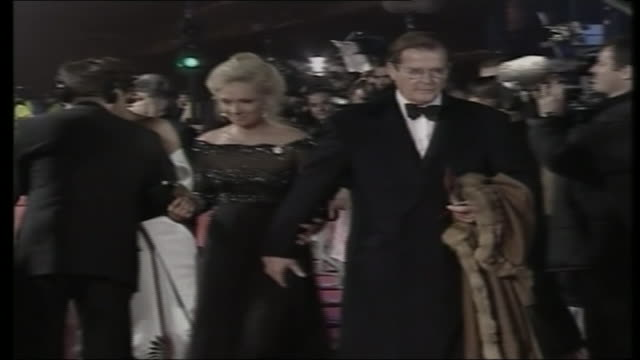 stockvideo's en b-roll-footage met queen elizabeth arrives in limosine / roger moore wife arrive red carpet walk / madonna arrives / pierce brosnan wife pose for photos / brosnan... - première