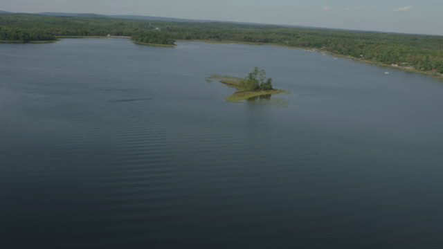 aerial of boats on lake. islands. trees in forests or woods. - nova scotia stock videos and b-roll footage