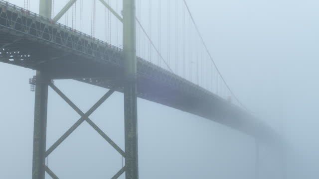 MEDIUM ANGLE OF A. MURRAY MACKAY BRIDGE WITH FOG OR MIST.