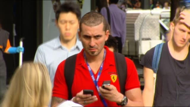 man on phone crosses st / man stands texting then crosses street still looking at phone as walks / female cyclist sits still looking at phone and... - pedone ruolo dell'uomo video stock e b–roll