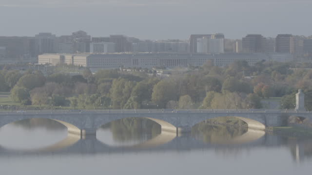AERIAL OF PENTAGON, GOVERNMENT OFFICE BUILDING. DEPARTMENT OF DEFENSE. WASHINGTON DC CITY SKYLINE IN BG.