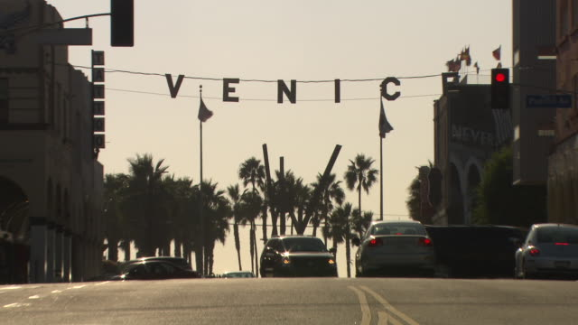 zoom in on signs over city streets at venice beach. pacific avenue. - venice beach stock videos and b-roll footage