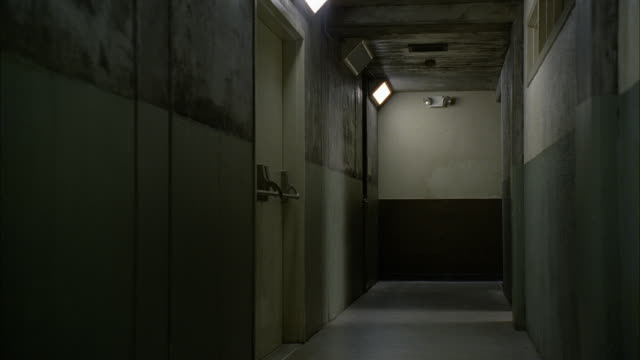 wide angle of chair being thrown out into hallway. could be office building. chair could be thrown in fit of rage. - corridor stock videos & royalty-free footage