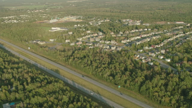 aerial of highway through middle class houses in suburbs or residential area. - nova scotia stock videos and b-roll footage
