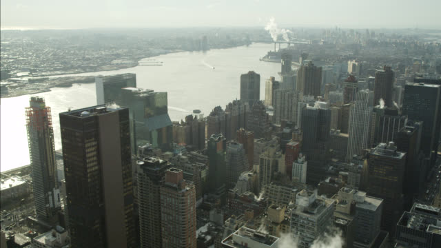 AERIAL OF NEW YORK CITY SKYLINE. EAST RIVER VISIBLE.