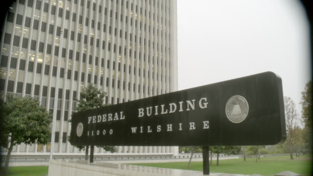 pan up of federal building in westwood, los angeles, ca. high rise office or government building. - westwood neighborhood los angeles stock videos & royalty-free footage