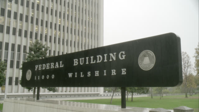 pan up of federal building in westwood, los angeles, ca. high rise office or government building. - federal building stock videos & royalty-free footage