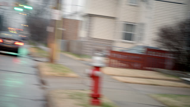 pan left to right of residential area street. lower to middle class houses. church. neighborhoods. - cleveland stock videos and b-roll footage