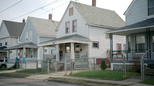 medium angle of two story lower class houses. - cleveland ohio stock videos and b-roll footage