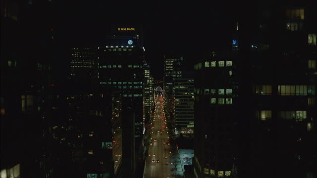 AERIAL OF VANCOUVER CITY SKYLINE AND VANCOUVER PUBLIC LIBRARY. SEE LIGHTS ON IN MANY HIGH RISES AND TALL OFFICE BUILDINGS