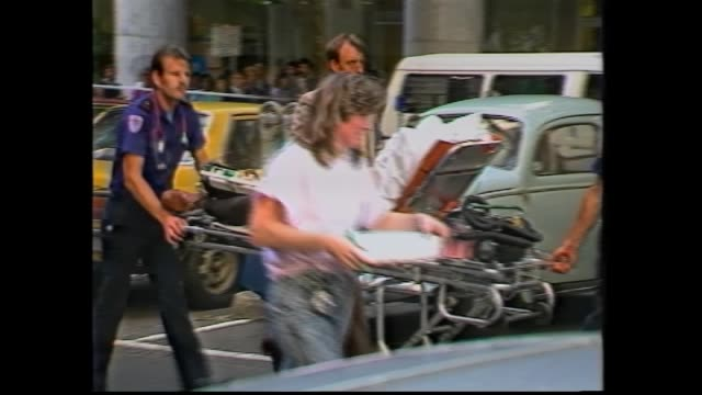 queen st massacre inquest day 4 - mark gillies reports: queen street file –wounded man john dyrak wheeled on ambulance stretcher trolley / court... - 検死官点の映像素材/bロール