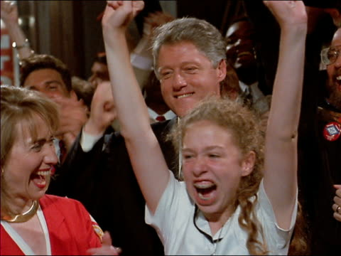 vídeos de stock e filmes b-roll de shaky close up clinton family cheering together / chelsea raising arms - 1992