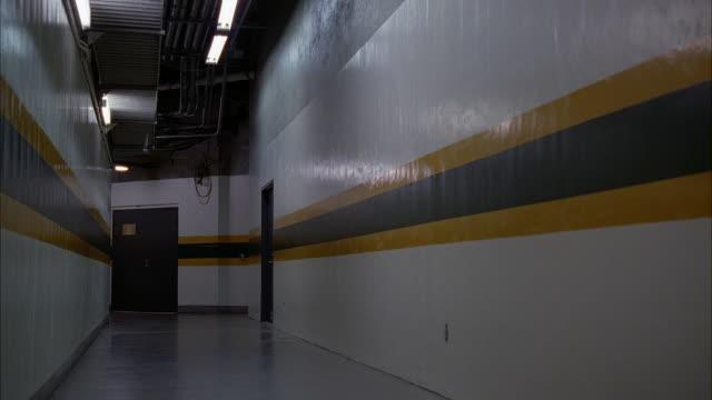 wide angle of tunnel or hallways under baseball or sports stadium. oakland athletics stadium. - baseball mal stock-videos und b-roll-filmmaterial