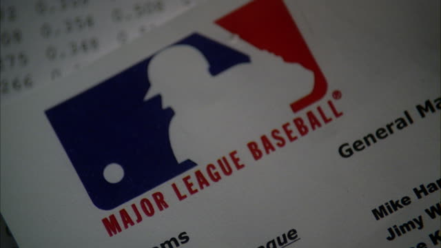 close angle of major league baseball logo on piece of paper. could be letterhead. could be office. - logo stock videos and b-roll footage