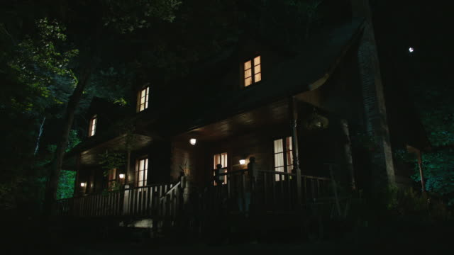medium angle of two story middle class lake or vacation house with porch. - front stoop stock videos and b-roll footage