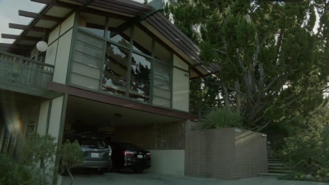 stockvideo's en b-roll-footage met pan down two story house. car in garage. could be silverlake. - vrijstaand huis