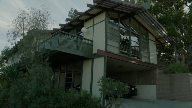 wide angle of two story house. car in garage. could be silverlake. - establishing shot stock videos & royalty-free footage