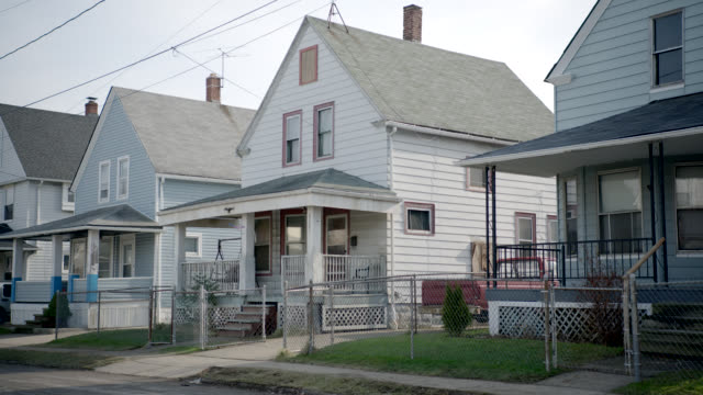 medium angle of two story lower class houses. - cleveland stock videos and b-roll footage