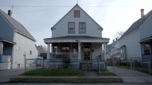 vidéos et rushes de medium angle of two story lower class house. - ohio