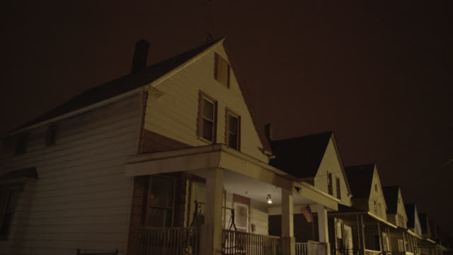 up angle of row of lower class two story houses. - cleveland stock videos and b-roll footage