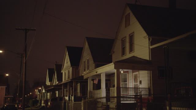 medium angle of row of lower class two story houses. - 建物入口点の映像素材/bロール