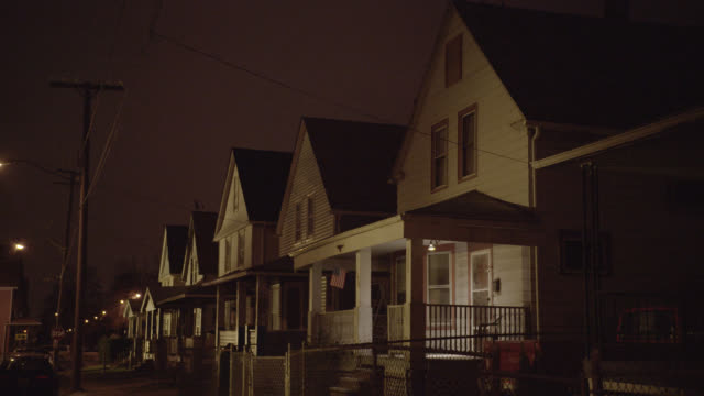medium angle of row of lower class two story houses. - cleveland stock videos and b-roll footage
