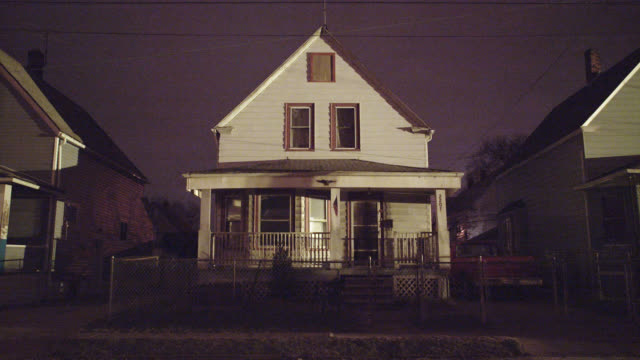 medium angle of lower class two story house. snowing or light rain. - cleveland ohio stock videos and b-roll footage