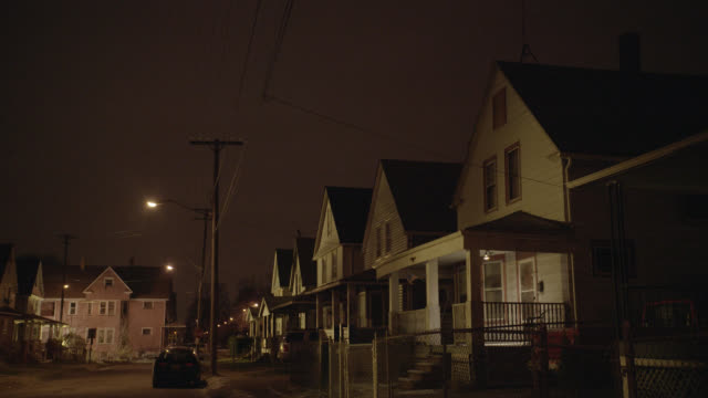 medium angle of row of lower class two story houses. light snow. - cleveland stock videos and b-roll footage