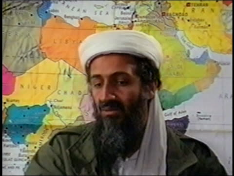 osama bin laden talking in front of map of northern africa and middle east / audio - al qaida stock videos & royalty-free footage