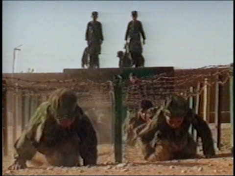 MS group of boys doing training exercises in Al Qaeda camp / crawling under barbed wire / AUDIO