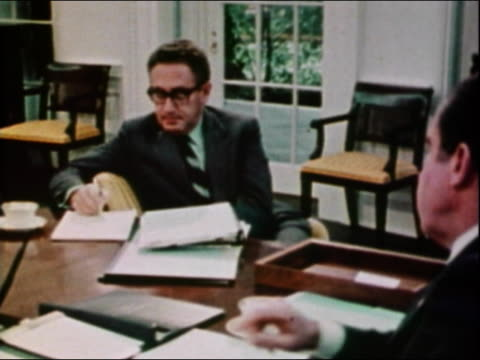 1970s high angle medium shot henry kissinger and president richard nixon sitting at desk + chatting in oval office - richard nixon stock videos & royalty-free footage