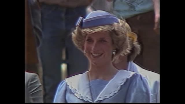 vídeos y material grabado en eventos de stock de mildura huge crowd / charles and diana out from car handshakes / injured woman / charles speech wind blowing hair and repeatedly smooths down / diana... - 1985