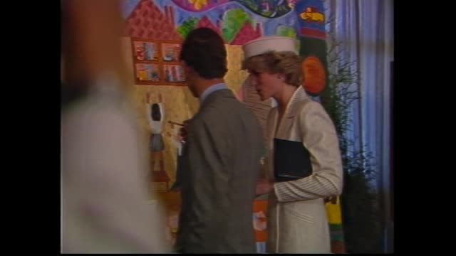 vídeos y material grabado en eventos de stock de prince charles diana visit patients / patients watch visit on tv / 13 year old patient chris king talks leg in plaster was hit by a car while riding... - 1985