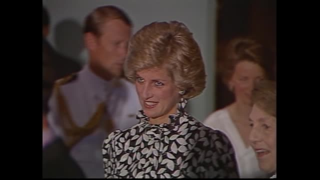 government house - people at pre melbourne cup reception / princes charles and princess diana mingle / prince charles chats with various - ron walker... - 1985 stock-videos und b-roll-filmmaterial