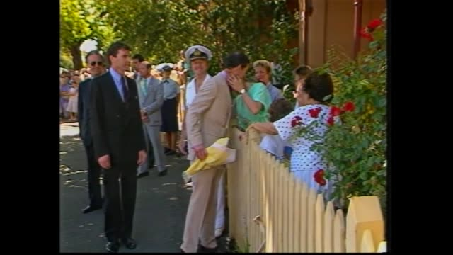 prince charles meet and greet with crowd / charles meets sutcliffe's at their south melbourne home through picket fence gate / jennifer sutcliffe... - charles bridge stock-videos und b-roll-filmmaterial