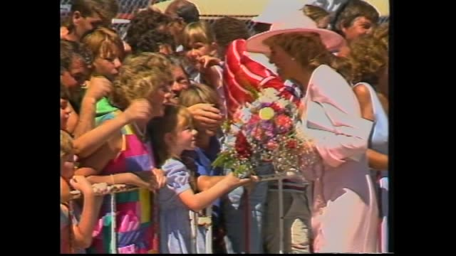 PRINCE CHARLES AND PRINCESS DIANA OFF PLANE DOWN STEPS / CHARLES WITH PREMIER JOHN CAIN / DIANA MEET AND GREET WITH CROWD / ROYAL CAR / BOAT TRIP...