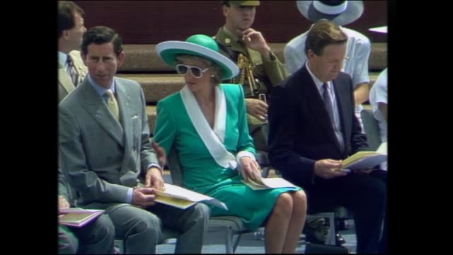 NAVAL MARCHING BAND / CLOSE UP PRINCE CHARLES AND PRINCESS DIANA CHATTING TO EACH OTHER AND TO NSW PREMIER BARRIE UNSWORTH DIANA APPLAUDING /...