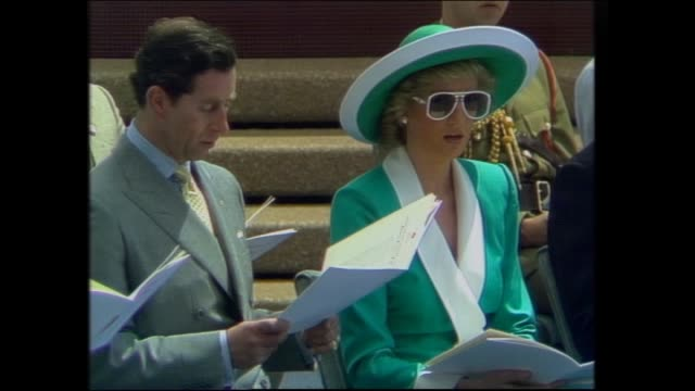 ALTERNATING SHOTS OF JOAN CARDEN CHOIRS SINGING BICENTENNIAL HYMN / PRINCE CHARLES AND PRINCESS DIANA SINGING / WIDE SHOT CEREMONY ZOOMING OUT TO...