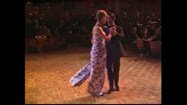 PRINCE CHARLES IN DINNER SUIT AND PRINCESS DIANA WEARING FULL LENGTH STRAPLESS ROYAL BLUE AND SATIN EVENING GOWN WITH GATHERED BODICE AND SLIM...