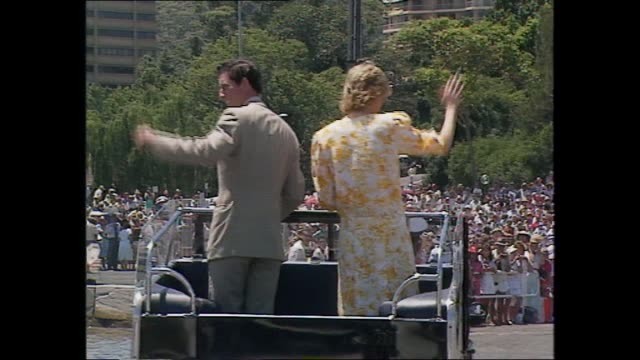 PRINCESS DIANA PRINCE CHARLES WALK ALONG JETTY AND INTO OPEN TOPPED LAND ROVER JEEP – WAVING AS PASS CROWDS ALONG FORESHORE