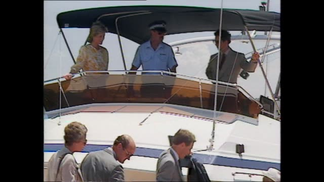 princess diana & prince charles arrive by motor cruiser - past flotilla of spectator craft / off boat - diana playfully slides down gangway ramp from... - 1988 stock videos & royalty-free footage