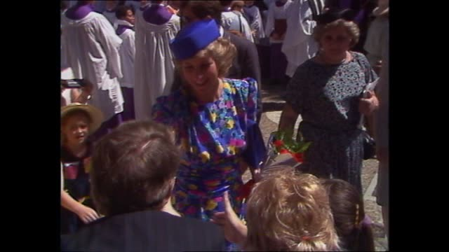 ext st andrews cathedral crowds press photographers / prince charles princess diana exit cathedral / princess diana walkabout meet and greet with... - meet and greet stock videos and b-roll footage