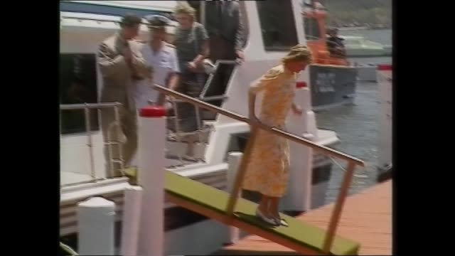 "sydney crowds ext st andrews cathedral prince charles and princess diana walk / diana meet and greet / crowd with sign ""dilightful"" / st johns... - meet and greet stock videos and b-roll footage"