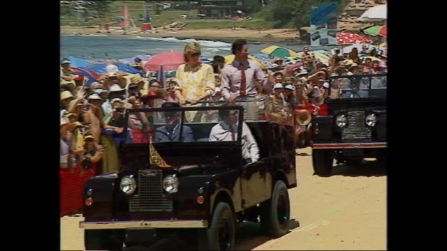 princess diana & prince charles wave as going past crowds along beach in open toppped land rover jeep / off jeep / meet and greet with nsw premier... - 1988 stock videos & royalty-free footage