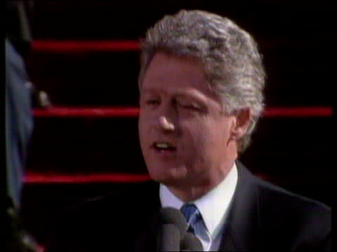 january 20, 1993 film montage crowd/ bill clinton inauguration speech - 'this is our time. let us embrace it.'/ clinton and crowd/ washington dc/... - 1992 stock videos & royalty-free footage