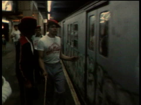 june 20 1979 film montage ms zo vigilante group 'the magnificent 13' patrol the subway at times square/ ms magnificent 13 members walking through... - reporterstil stock-videos und b-roll-filmmaterial