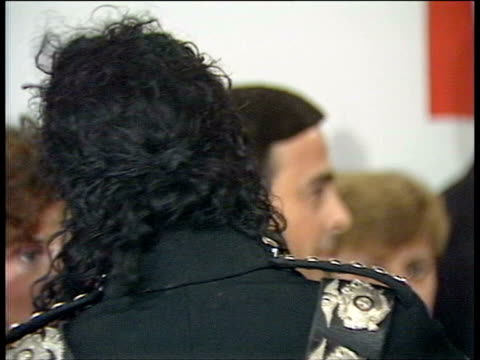 July 16 1988 FILM MONTAGE CU TD Michael Jackson being photographed at Prince's Trust charity/ WS People in line against wall/ London England/ AUDIO